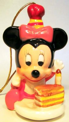 Baby Minnie Mouse with cake ornament