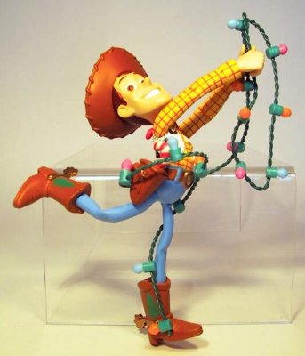 Woody tangled up in Christmas lights ornament (Grolier ...