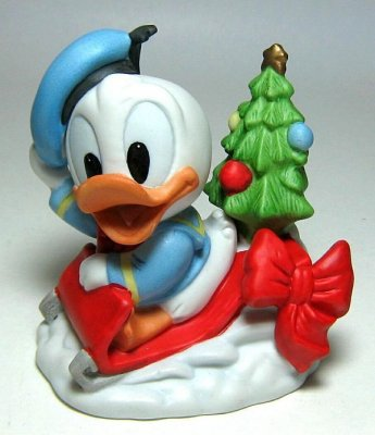 Baby Donald Duck On Red Sled Bisque Ornament From Our